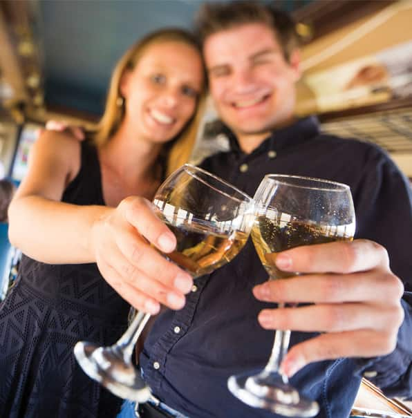 Couple with Wine Glasses Toasting